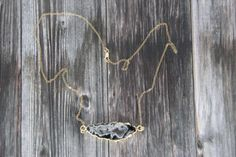 Electroplated Black Druzy Agate, Druzy Agate Slice Pendant, Druzy Necklace, Black Druzy Necklace, Sparkling Druzy Necklace, 24k Gold, Gray  Love to shine?  This grade AA natural black druzy agate sure does. High quality gemstone is electroplated in 24k gold and is even more beautiful in person. Coloring is mostly gray/black with a generous sparkle at the center, which catches the light as you move. All finding are high quality 14k gold filled. You will receive the exact necklace shown in…