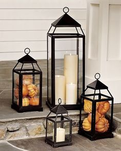 Fall Decor - Front Porch Lanterns Filled with Mini Pumpkins and Gourds.