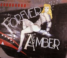 """""""Forever Amber"""" from the Confederate Air Force Collection.  This collection of nose art panels came to the CAF from Minot Pratt, the general manager of the company that was scrapping planes at the boneyard at Walnut Ridge, Arkansas.  He had ordered his men to cut out and save the most interesting nose art, which he was supposedly going to put up as a fence around his property.  This never happened and he donated the pieces to the CAF in the 1960's."""