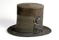 Beaver Top Hat featuring silk black band and mourning button commemorating Lincoln assassination. (c. 1865).