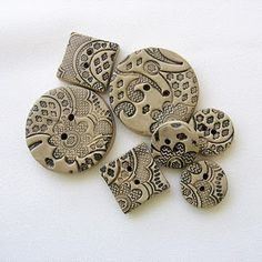 Clay buttons using lace to imprint.