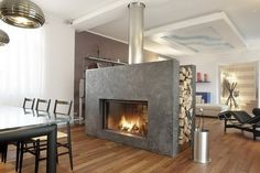 two sided wood burning fireplace  - Transform your Spacious Space with a Double-Sided Fireplace