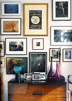 art wall. I think I prefer this style, where there are different frames and sizes and no real arrangement.