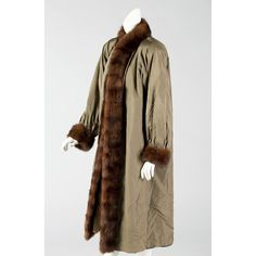 A Mink Lined and Trimmed Coat, Yves Saint Laurent Sold $1,600