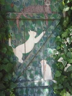 Painted garden gate. Like the idea, not the cats, maybe bunnies and birds.