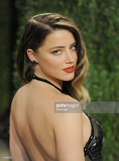 Actress Amber Heard arrives at the 2013 Vanity Fair Oscar Party at... News Photo | Getty Images