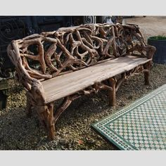A long rustic bench fashioned from vine roots