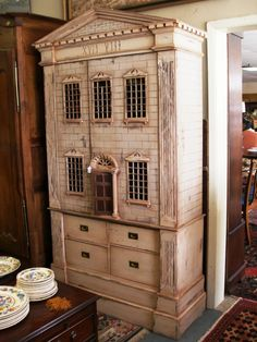 Painted Dollhouse Bookcase or Armoire ~ Caboose Antiques (jt-not seen this one before. I wonder what the 17 and 8 in Roman numerals refer to?)