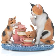 """Kitties Tea Time Figurine by Lenox Mother cat and kittens are enjoying high tea in the adorable Kitties Tea Time figurine. The kittens are exploring a tea pot and lapping from a cup and saucer while mother cat looks on. Masterfully crafted of artist's resin and meticulously painted by hand, this figurine is perfect of cat and tea lovers everywhere. •Crafted of hand-painted resin •Width: 5"""""""