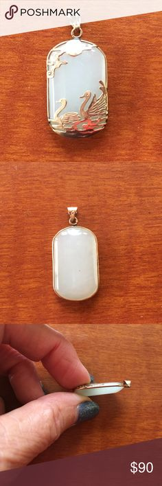 CHINESE TAIWANESE GOLD & PALE GREEN JADE PENDANT VINTAGE CHINESE TAIWANESE GOLD & PALE GREEN JADE PENDANT FOR NECKLACE  THIS WAS MINE - BOUGHT FOR ME BY SOMEONE IN TAIWAN IN THE 1980s  EXCELLENT CONDITION!!!  LOVELY DESIGN AND WORKMANSHIP - GOLD CRANES OR SWANS SWIMMING - NICELY DETAILED  LOOKS LIKE THIS WAS MADE BY HAND  ENTIRE PIECE IS TRIMMED IN GOLD  HAS GOLD BALE TO ATTACH A CHAIN  MAKER'S MARKS ARE ON BALE.  COMES FROM SMOKE FREE AND PET FREE ENVIRONMENT!!! Jewelry Necklaces