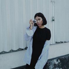 black cloth & blue striped shirt