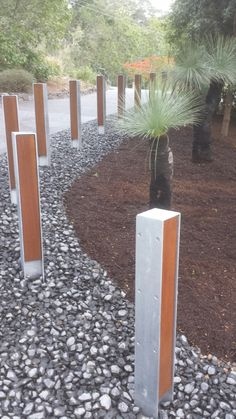 Galvanized steel bollards with oiled Australian hardwood. Bluestone Balust mulch with large black boys/grass trees by EcoBuilt Landscaping. Find us on Facebook. Native Australians, Australian Plants, Black Boys, Galvanized Steel, Native Plants, Large Black, Grass, Hardwood, Landscaping
