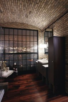 brick walls and ceileing, wide plank wood flooring, gorgeous view - incredible for a bathroom