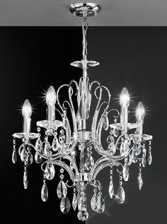 FL2156/2 Brocadedouble wall light, chrome and crystal. Chrome finish fitting with crystal glass drops and tiny crystals inset into the arms. 2 x 60w E14 Candle Lamps not included Height- 40.5cm Width- 37cm Projection- 17cm BRAND: Franklite REFERENCE: FL2156/2 AVAILABILITY: 3-4 Working Days