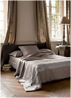 curtains behind bed- can use burlap or painter's drop cloth for a similar look