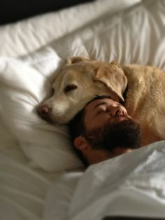 This picture reminds me of Kyle and his love for dogs.  .  . Funny thing is. . . The guy actually looks like him too.