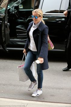 Fresh:The Legally Blonde beauty also had on fitted denim jeans, white sneakers and held o...