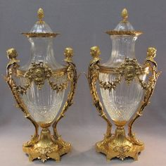 20th C. Baccarat pair of glass & bronze urns