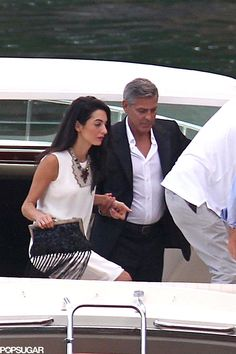 George Clooney and Amal Alamuddin appear to be getting ready for their wedding in a big way; the engaged couple walked hand in hand around Lake Como, Italy, George Clooney Wedding, George Clooney Amal Alamuddin, George Clooney Images, Airport Attire, Human Rights Lawyer, Lake Como Italy, New Ferrari, Celebs, Celebrities