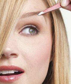 Blonde model tweezes eybrows | Tips for saving overplucked eyebrows.