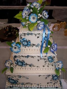 Tulsa Cake Show by Ally Cake Designs, via Flickr. Beautiful wedding cake with blue floral design.