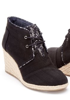 Elevate your everyday look with our Desert Wedge Bootie. Featuring floral linen trim and a rope sole, it gives casual outfits a pop of style.