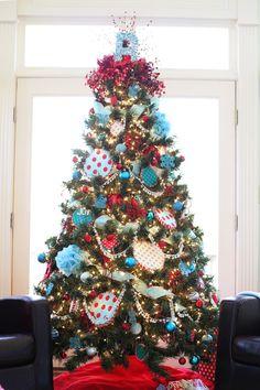 I LOVE how full this Christmas tree is! I want to learn to do ribbon. and pom-pom trim. pom-pom trim. POM-POM TRIM!