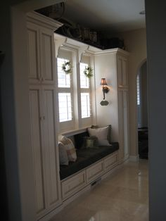 Window seat and pantries in hallway off entry & kitchen (D&T;)