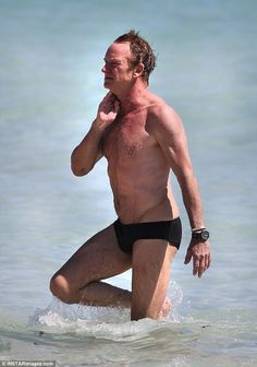 Beach bod: Sting, 65, shows off his physique in just a Speedo on the beach in Miami... one...
