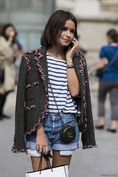 Miroslava Duma wears cuffed denim shorts + striped t-shirt... and the coolest little #Chanel purse // #fashion #style #streetstyle