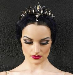 Black Swan stage makeup. Personally it reminds me of the evil step Mum from Snow White