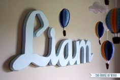 DIY custom wood signs hand-cut with a jigsaw out of scrap plywood. Great for kids' bedrooms and nursery wall decor!