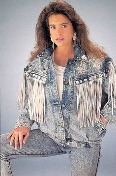 1980's- Hard Rock inspired Acid Washed jeans with jean jacket that has fringe. Women also has the typical 80's hairstyle.