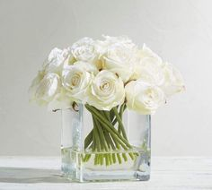 This lovely grouping of white roses looks as though freshly picked from the garden. The Faux Composed Roses in Square Vase add a springtime feel to a room. Simple Wedding Centerpieces, Flower Centerpieces, Flower Vases, Flower Decorations, Wedding Decorations, Flower Bouquets, Bridal Bouquets, White Floral Centerpieces, Centerpiece Ideas