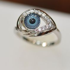 Evil Eye Ring - For those who like wearing eyes on their fingers comes the Silver & Cz Evil Eye Ring by DiamondJewelryNY. This odd and beautiful ring will cert. Weird Jewelry, Eye Jewelry, Jewelry Box, Jewelry Accessories, Jewelry Design, Unique Jewelry, Jewlery, Diamond Jewelry, Evil Eye Ring