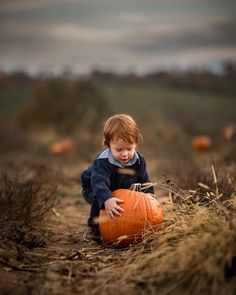 Both kids found pumpkins far too large for their little arms. by adriancmurray
