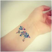 What does world tattoo mean? We have world tattoo ideas, designs, symbolism and we explain the meaning behind the tattoo. Watercolor Map, Watercolor Tattoo, Map Tattoos, Get Instagram, World Tattoo, Mandala Tattoo, Tatting, Ink, Tattoo Ideas