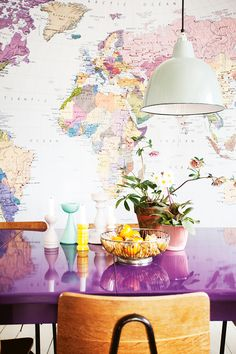 This is a great styling tric for those who like big, bold statements: choose the largest worldmap possible and paint a piece of furniture in the most striking colour on the map. For extra effect, add a pretty rug.