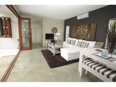 Modern living room, sliding glass wall, polished concrete floor.