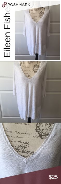 """Eileen Fisher Sweater Tunic White Large V Neck Eileen Fisher Sweater Tunic White Large V Neck Organic Linen Cotton  Excellent pre-owned condition  Elbow length sleeves  100% organic linen and cotton Approximate Measurements: Bust- 22"""" Length- 30""""  Thanks for looking and please check out the rest of my closet! 🐞 Eileen Fisher Sweaters V-Necks"""