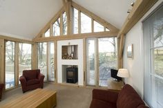 Living Room Interior with Exposed Timber Frame and Glazed Gable End by Carpenter Oak room interior Oak Framed Extension - The Counting House on Dartmoor Bungalow Extensions, Garden Room Extensions, House Extensions, Kitchen Extensions, Oak Frame House, A Frame Cabin, Oak Framed Extensions, Tin House, Living Room Interior