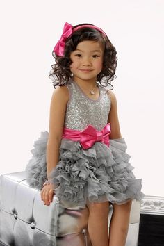 Sequinned ruffle dress by Oh La La Couture. Flower girl glam. http://www.everythingbuttheprincess.com/Ooh-La-La-Couture-Silver-Sequin-WOW-Dream-Dress_p_9246.html#