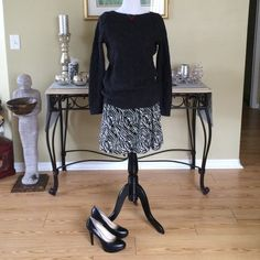 BANANA REPUBLIC SKIRT Super cute, brand new with tags size 6 zebra striped skirt.  Light cotton fabric lined with the same fabric in black.  The waist measures 15.5 inches across (layed flat) and 19 inches long. Banana Republic Skirts A-Line or Full