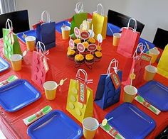Easy Lego favor bags. Buy cheap, colored gift bags and affix card stock circles :)