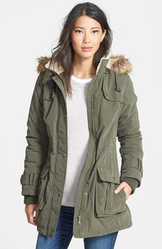 Free shipping and returns on DKNY Faux Fur Trim Anorak at Nordstrom.com. A fluffy faux-coyote fur ruff tops the zip-off hood while faux shearling lines the collar of a cold-weather anorak with an inner drawstring cinching the waist. Rugged utility details include snap-down gunflaps, a storm placket, dual-entry cargo pockets and rib-knit cuff inserts.