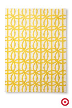 A lively graphic pattern adds a bright, warm look to your décor. This linked circles area rug is a great choice for the nursery or any room that needs a pop of color.