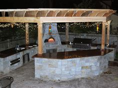 Outdoor Kitchen with Oven, Bar, and Sink. #Landscaping #Minnesota #LandscapeDesign http://www.spearslandscape.com/gallery/outdoor-living/