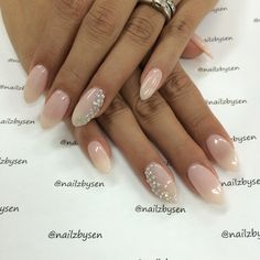 Love my nails!!! Almond shaped, pale pink with rhinestones!