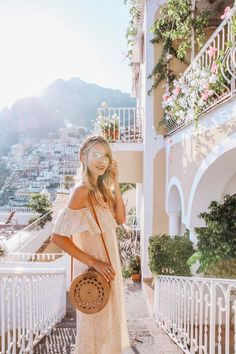 This photo has got me totally dreaming of Positano! Her outfit is perfection too. Trendy travel. Summer style. Summer outfit. Ohhcouture, leonie hanne, basket bag, off shoulder dress