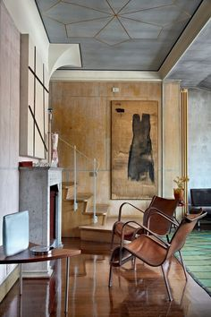 abstract art, geometric design ceiling, leather and metal chairs-love love love